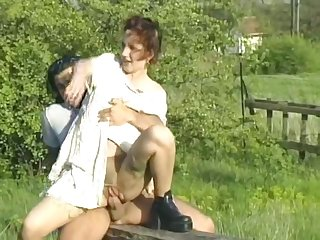 Pantyhose redhead fucked adjacent to a meadow