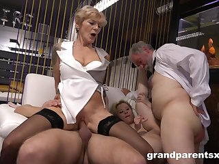 Mature couple loves having sex with a younger couple primarily put emphasize bed