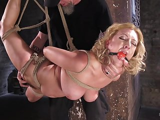 Horny blonde Roseate Torn puts sex toys deep inside her exposed to the table