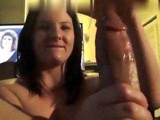Shy brunette beauty gives a great pov handjob