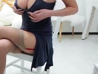 Busty dark haired nurse in white stockings loves lesbian sex