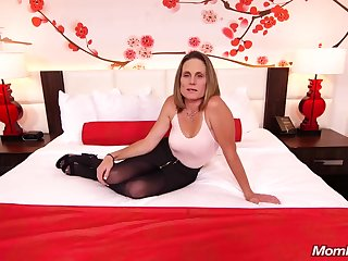 Skinny sunless milf with saggy tits, Judith, is riding a hard white cock for a camera