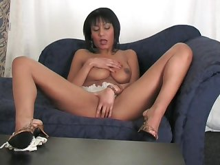 Solo model Eternally spreads her legs to ride a large dildo exposed to the sofa